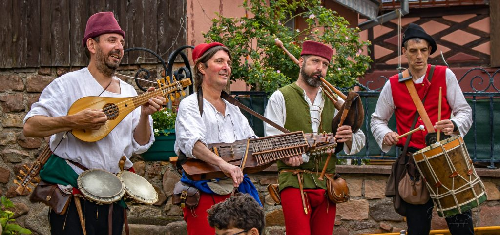minstrels of the early music ensemble Hauvoy playing their medieval musical instruments