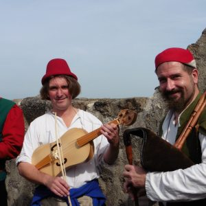 Hauvoy's minstrels posing with their medieval instruments at the Haut-Koenigsbourg's castle