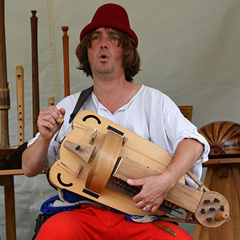 minstrel playing the hurdy-gurdy