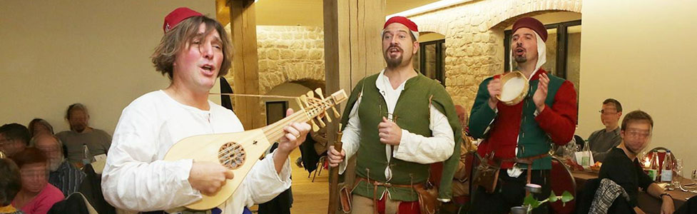 The Hauvoy ensemble playing and singing at a medieval banquet